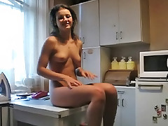 Pretty girlfriend having sex with her boyfriend before cooking dinner