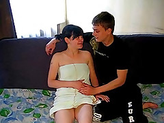 He feels up her nice teen tits as he kisses her