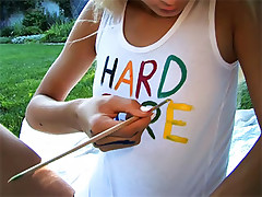 Adorable petite teen paints all over her naughty bits